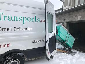 off loading. ramps in snow.jpg