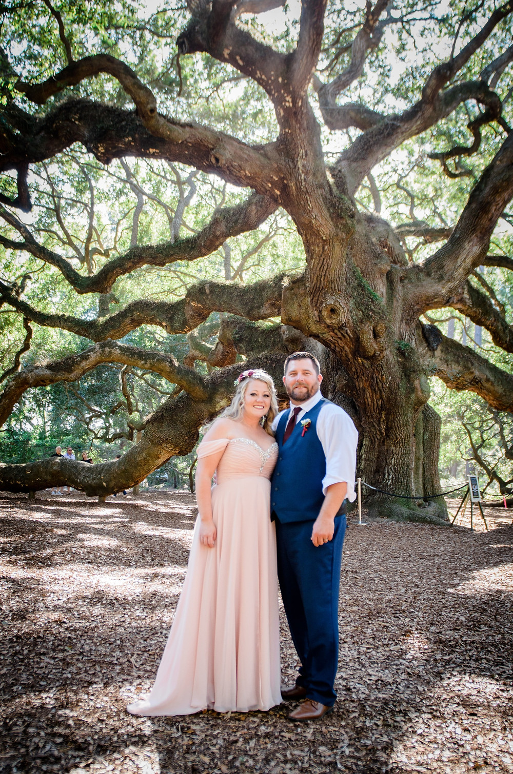 Bride and Groom stand in from of the famous Angel Oak