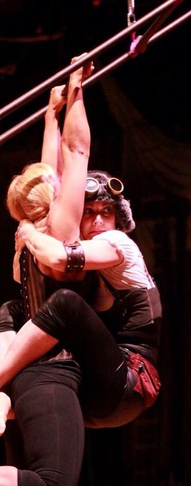 """Hanging on for dear life to my partner Amber Ebert for the """"Canopy Con"""" show in 2015. Steampunk is my fave costume look."""