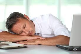sleep man on desk