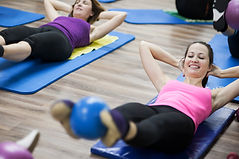 People enjoying a Pilates class