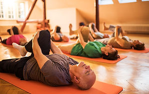 Class performing stretches to relieve back pain