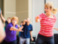 Men and women in older adults' keep fit aerobics class