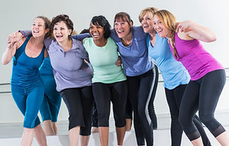 Group of women enjoying exercise class together