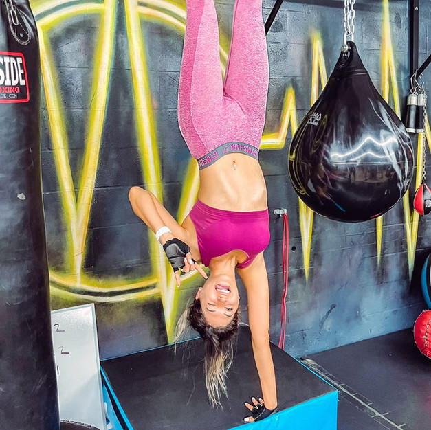 Customer at the gym hanging upside down for a cool shot