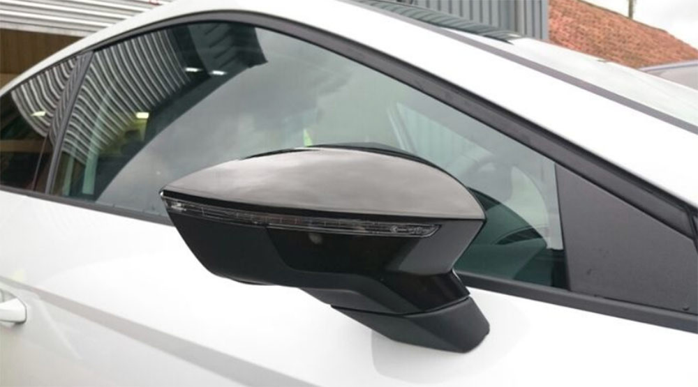 Gloss black vinyl wrap used on a car side mirror from a blog post about wing mirror wrapping by Autowrap Centre Liverpool
