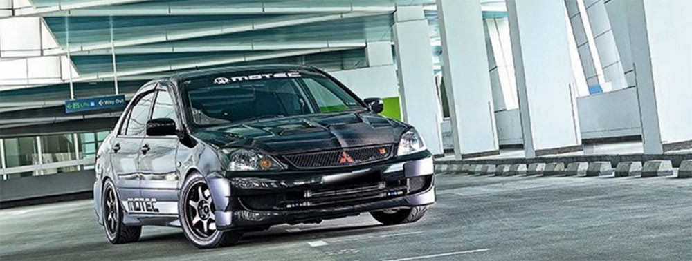 Image of a modded Mitsubishi Lancer used in a blog post by Autowrap Centre Liverpool about the best Japanese cars for under £5000 for tuning