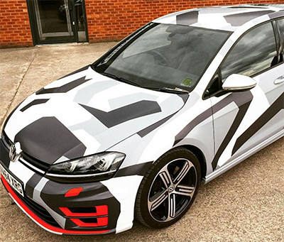 Image showing a VW Golf with a full digital camo car wrap used in a blog post by Autoharp Centre Liverpool