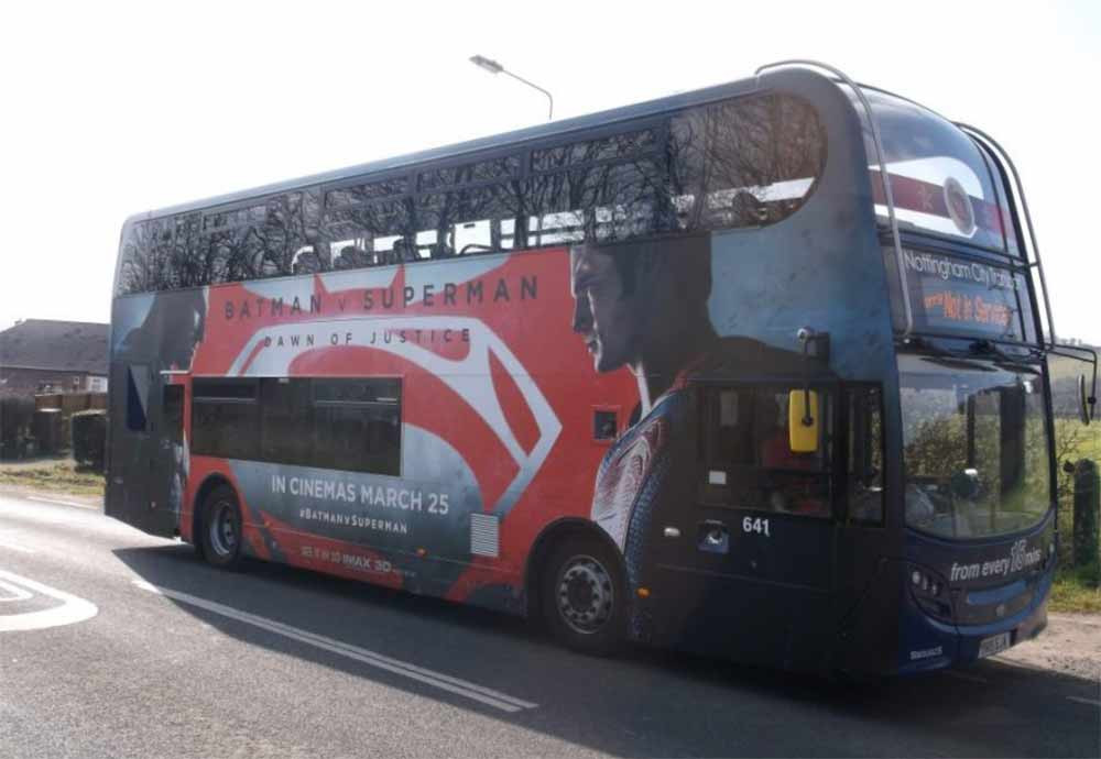 Image showing a bus with batman vs superman graphics used in a blog post about super hero vinyl graphics by Autowrap Centre Liverpool