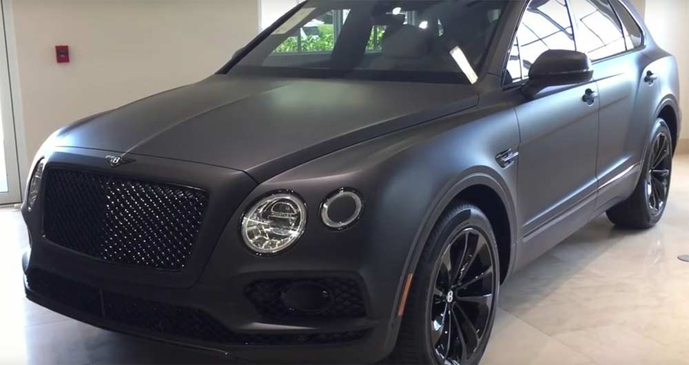 Image showing a Bentley car with the matte black stealth car wrap used in a blog post about stealth car style by Autoharp Centre Liverpool