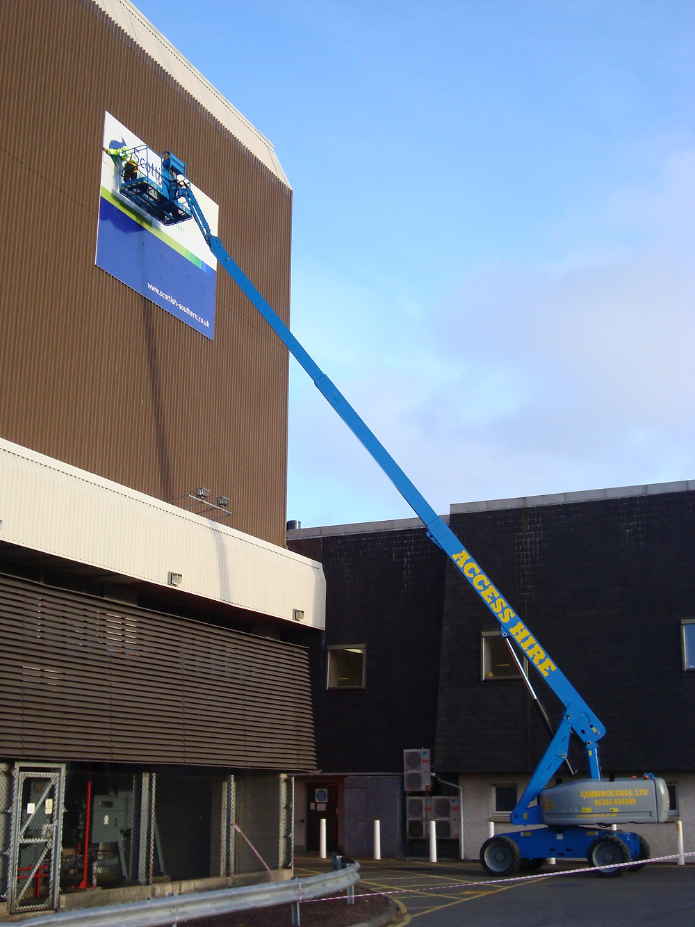 Image of a large external sign being fitted after manufacture by EP Cowens sign maker of Birkenhead