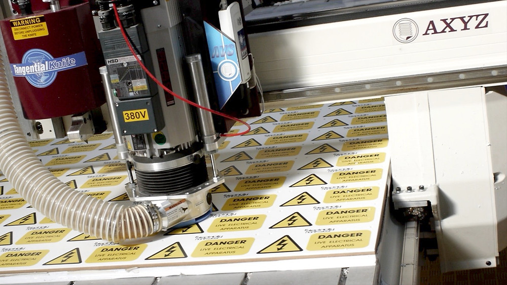 Image showing health and safety signs being manufactured in-house at EP Cowens