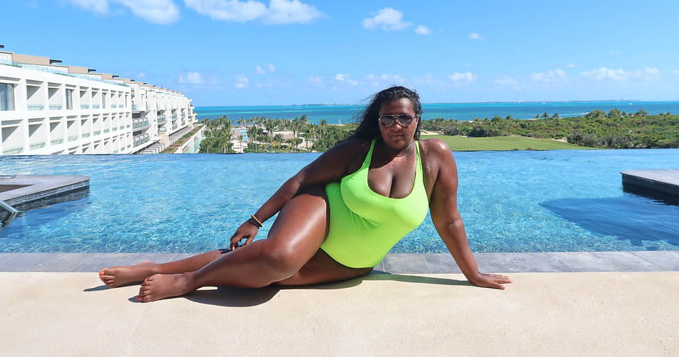 Kat Henry Pool Shot Mexico Atelier Playa Mujeres Cancun Woman of colour green neon swimsuit