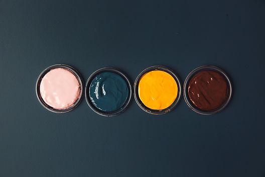 vibrant-pots-of-paints-on-a-blue-table.j