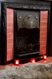 Original tiled fireplace in bedroom