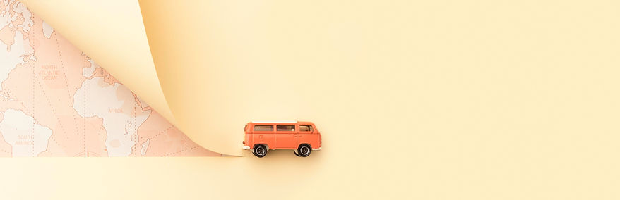 travel-concept-with-map-toy-van.jpg
