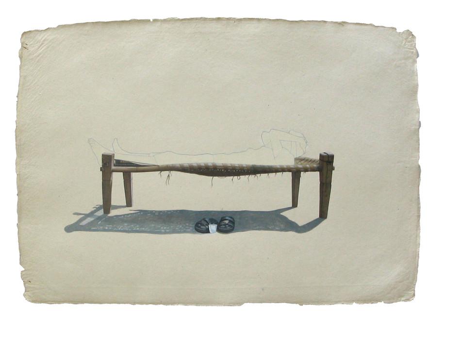 Man lying on charpoi.