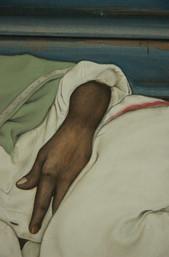 Man asleep near a shutter detail II.