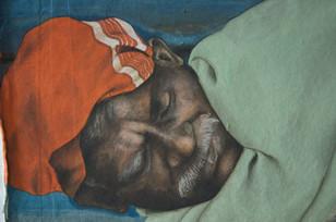 Man asleep near a shutter detail I.