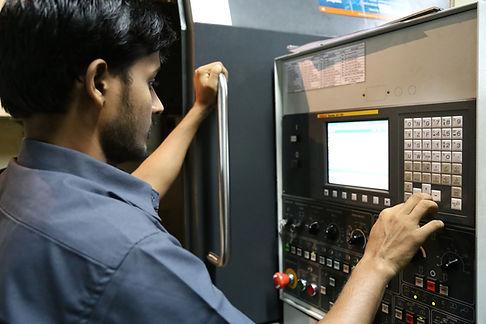 Machinist Working on CNC Machine