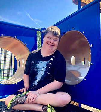 Smiling boy sitting on a playground
