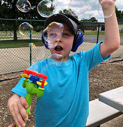Boy playing with bubbles