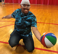 Smiling boy with glasses with basketball