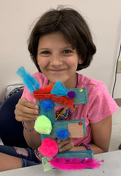 Girl smiling holding an art project
