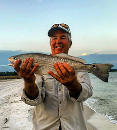 redfish tarpon surfing lessons paddleboard cape san blas shark charters