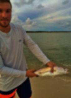 trout redfish tarpon shark charters surfing lessons