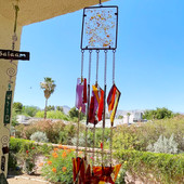 Glass peices were made to resemble Tucson Sunsets.  The full fuse parts include purples, poranges and yellows.