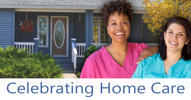 """African American and Caucasian female nurses in front of blue house with text """"Celebrating Home Care"""""""