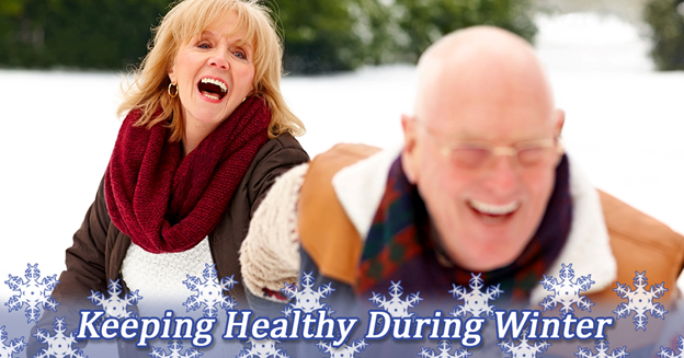 Keeping Healthy During Winter. Senior couple playing in the snow.