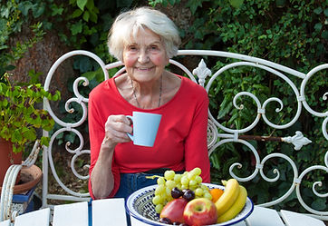 vecteezy_old-woman-having-a-coffee-at-th