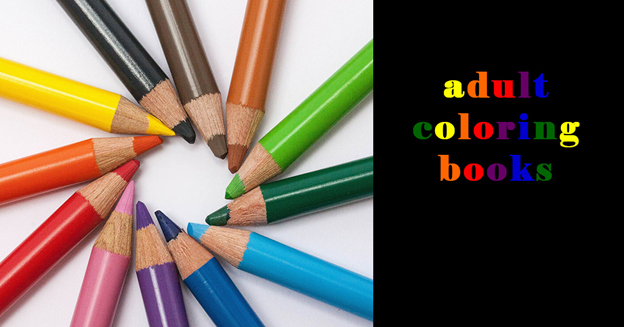 """A group of color pencils with text """"Adult Coloring Books"""""""