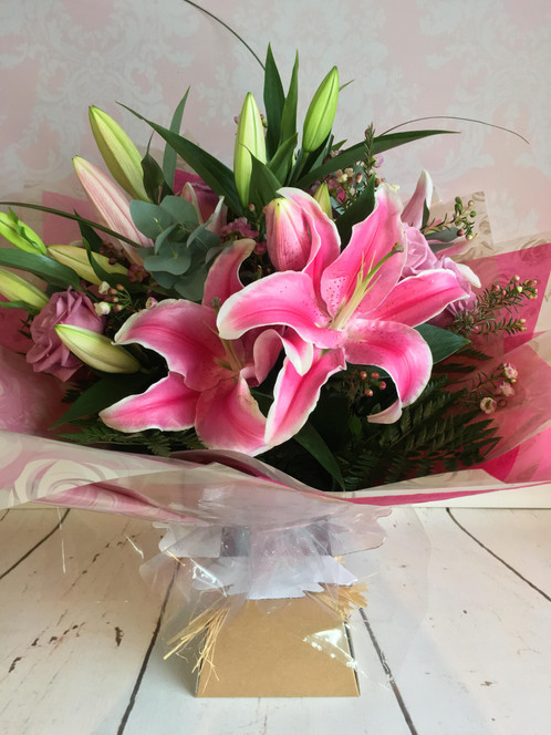 Pure pink a very pink bouquet of top quality pink roses and pink lilies the flowers are arranged in water filler flowers may vary shade of rose may vary depending mightylinksfo