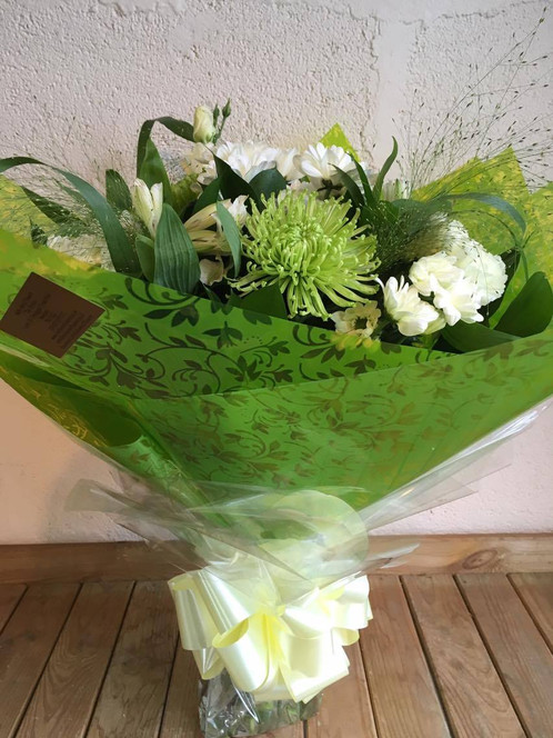 Fresh a long lasting mixture of green and white flowers arranged in a handtied bouquet in water flowers may vary mightylinksfo