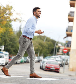 Dubai-based Property Owner Walking Down the Street