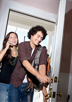 Young Couple Arriving to their Shosty vacation rental