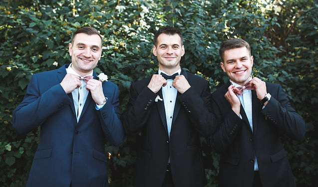 three-men-suits-posing-garden.jpg