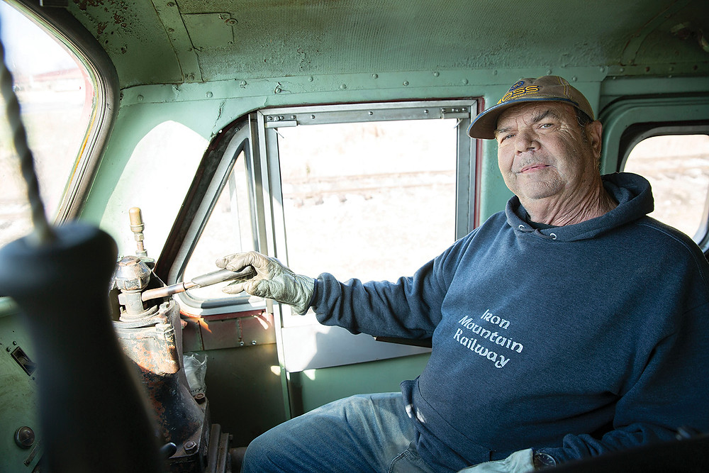 older engineer sits at the controls in the drivers seat of St. Louis Iron Mountain & Southern railway train