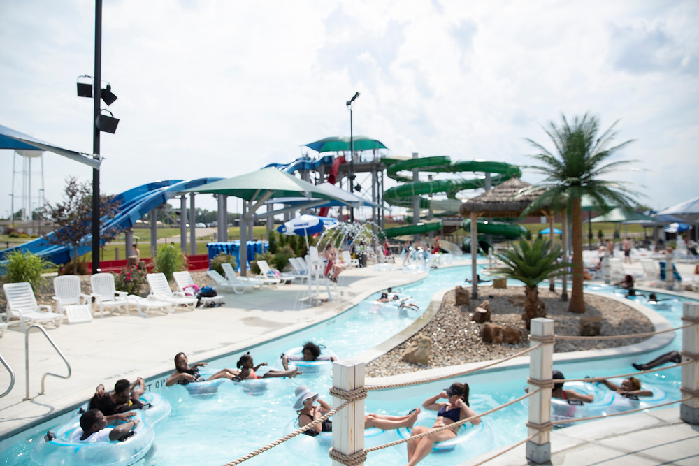Happy park goers float carelessly down the lazy river at River Rapids Water Park