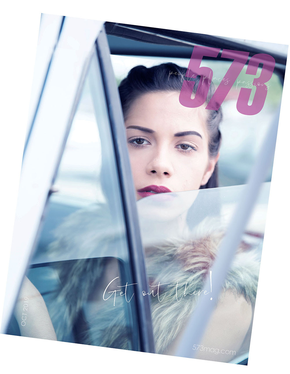 2019 573 magazine cover depicting young brunette woman in classic truck staring out the window