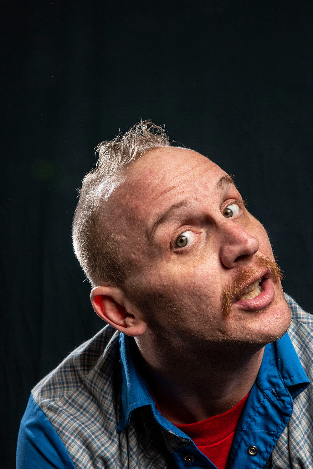comedian Nate Barron tilts his head and gives a goofy look