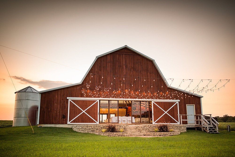The Barn at Lone Eagle Landing wedding venue silo and veranda outdoor dance floor with twinkle lights