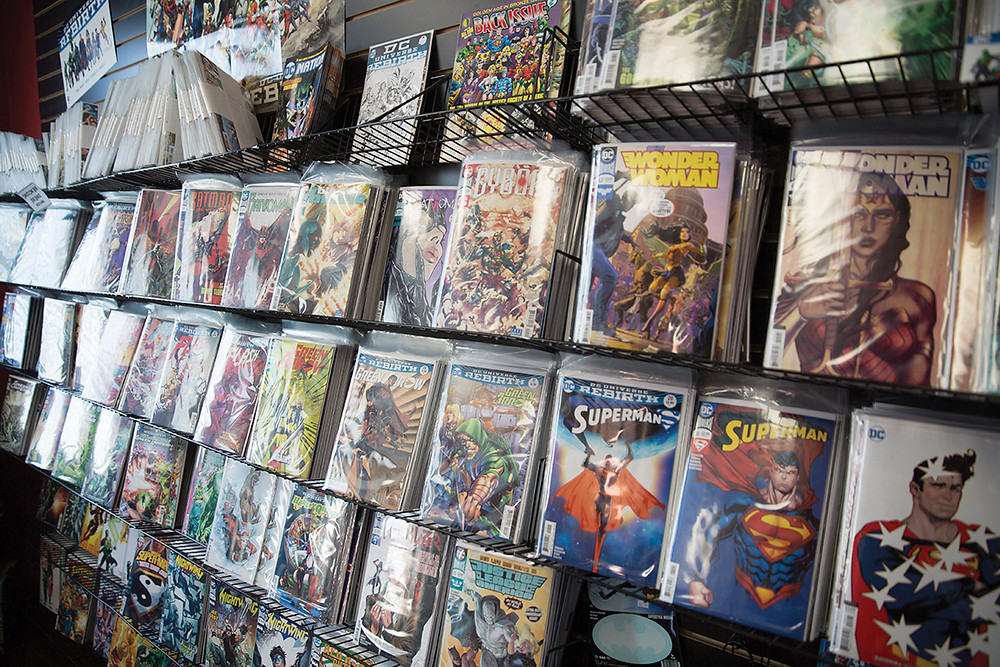 A wall of shelves containing a large variety of comic books
