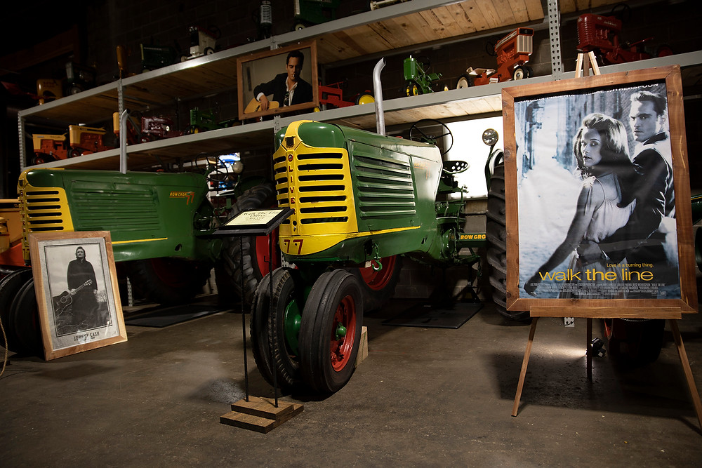 A display of the antique 1950 and 1951 Oliver Tractors used in the film Walk the Line with film posters and pictures of Johnny Cash surrounding them
