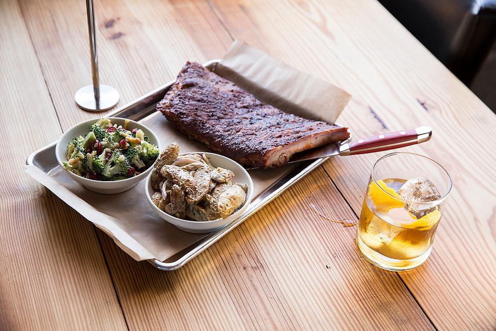 St. Louis Ribs with Broccoli Salad & Roasted Potato Salad and a glass of bourbon at Mary Jane Bourbon & Smokehouse