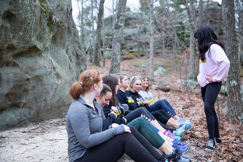 personal trainer Tamatha Crowson stands and talks to her class of enthusiastic women at Pickle Springs state park