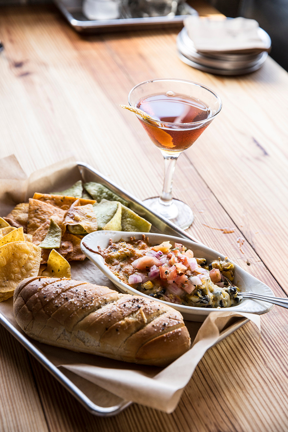 Hot Black Bean & Corn Dip with house chips & baked bread and a bourbon drink at Mary Jane Bourbon & Smokehouse